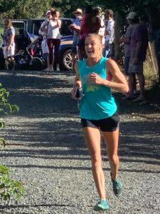 Chelsea Baranowski runs through to the finish line at 8TuffMiles 2020 on St. John